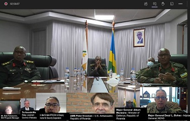 Screenshot of teams meeting with uniformed personnel and the chat box open on right side
