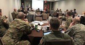 West Virginia National Guard members sitting at tables in workshop