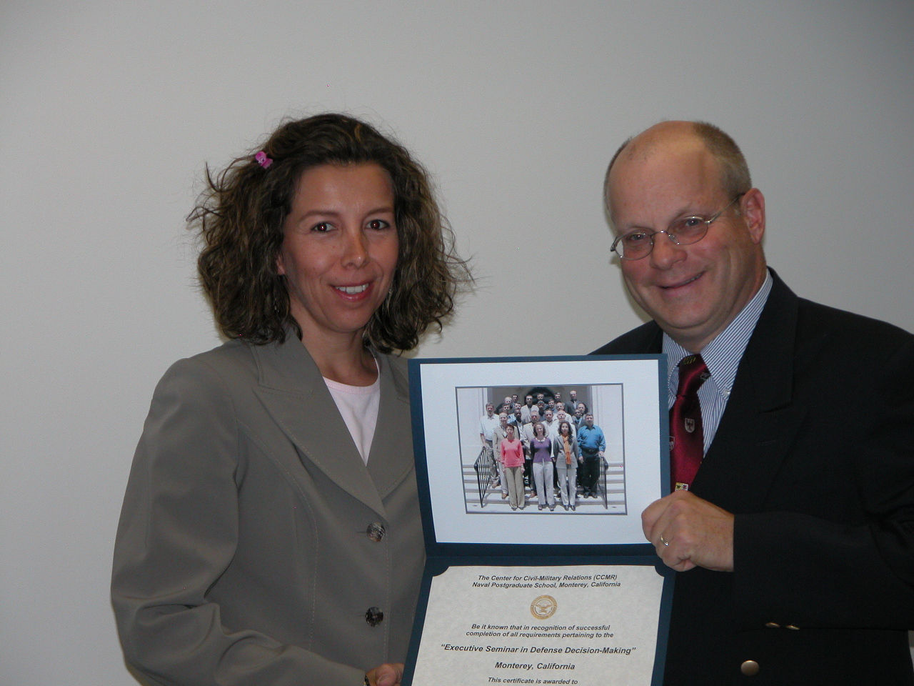 CCMR director Rich Hoffman presents a  participant with a course certificate, 2005